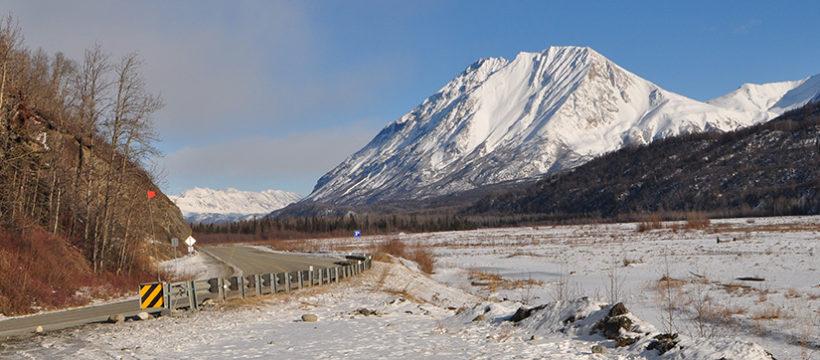 Road through snowy mountain