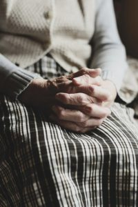 Why Worry--older woman's praying hands in her lap
