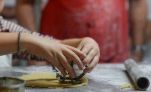 Making Turtles 2-child making cookies