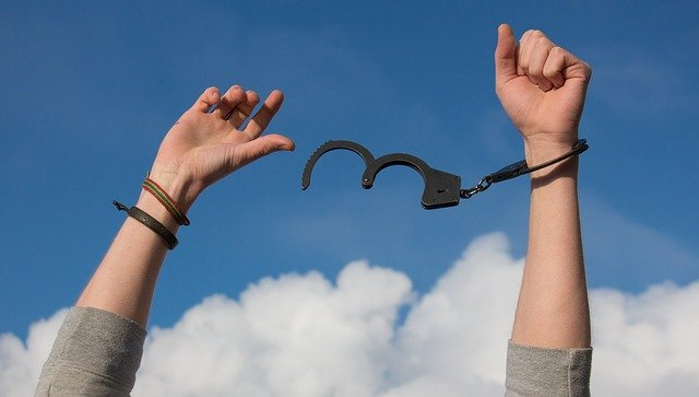 Lessons from a Dog Named Hope: arms raised to sky, breaking free from handcuffs https://pixabay.com/photos/freedom-sky-hands-handcuffs-clouds-1886402/