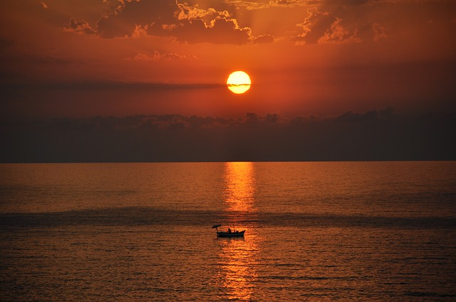 Twelve Ways to Stay Afloat in a Sea of Responsibility-boat in sea under moonlight