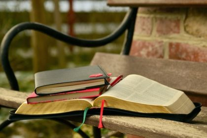 Dad's Memory Glitch-Open Bible and books on bench