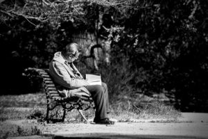 Dad's Memory Glitch-older man with book on bench
