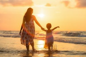 Mom's Never-Failing Gift-Mother and daughter walking on beach