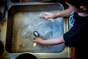 International Ministry- child washing dishes